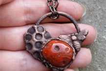 Closeup View of Deep Red Carnelian Gemstone Bee Necklace